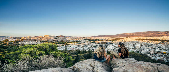 2 people on rock in Athens