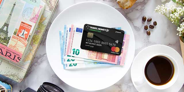 Currency Pass and Euro cash on table